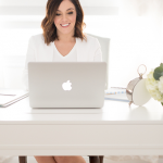 professional-girl-typing-on-a-mac-laptop-white-office
